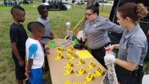 Crime Scene workers share their trade with children.